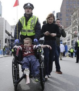 Injured child escorted by police after Boston Marathon bombing. Screen shot  via Fox News.