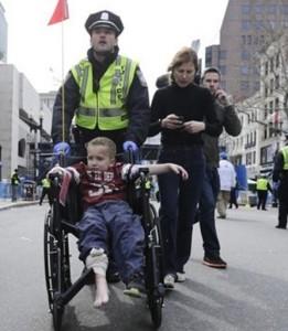 Injured child escorted by police after Boston Marathon bombing. Screen shot via Fox News.
