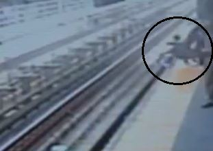 Video captures baby falling onto train tracks. Screen shot via ABC News.
