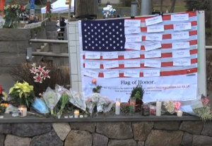 A memorial set up to honor 20 six-year-olds who were killed by 20-year-old serial killer, Adam Lanza. Photo via Voice of America.