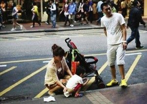 Tensions rise after China mainlanders cause firestorm for letting tot pee in middle of Hong Kong Street. Photo via http://www.scmp.com/